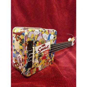 Custom Simpsons Ukulele / Cigar Box Guitar by Uncle Buck