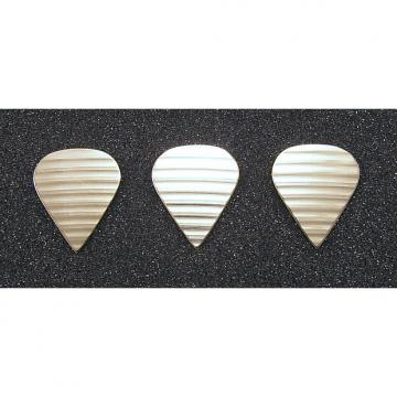 Custom Handmade 3 bronze guitar picks made from damaged cymbals. Tortex Sharp style.