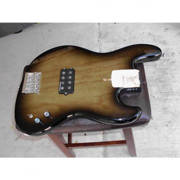 Custom WARMOTH swamp ash with duncan musicman series parallel switch in blackburst transparent