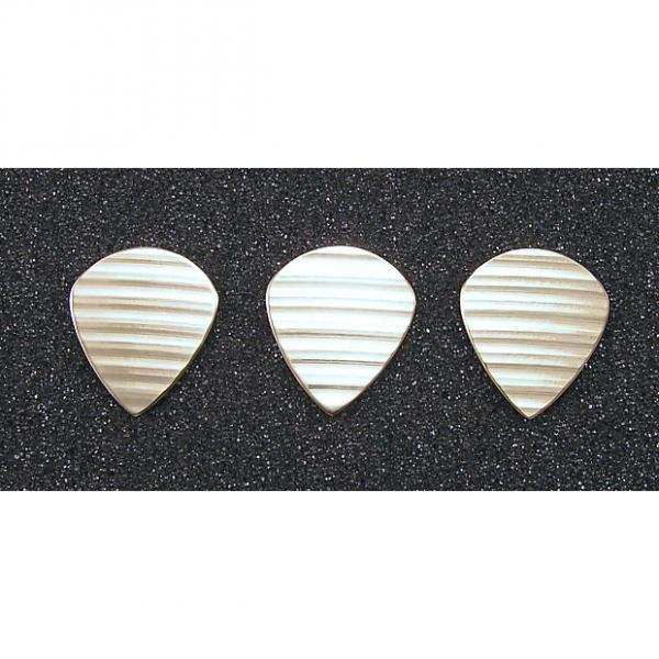 Custom Handmade 3 bronze guitar picks made from damaged cymbals. Jazz III style. #1 image