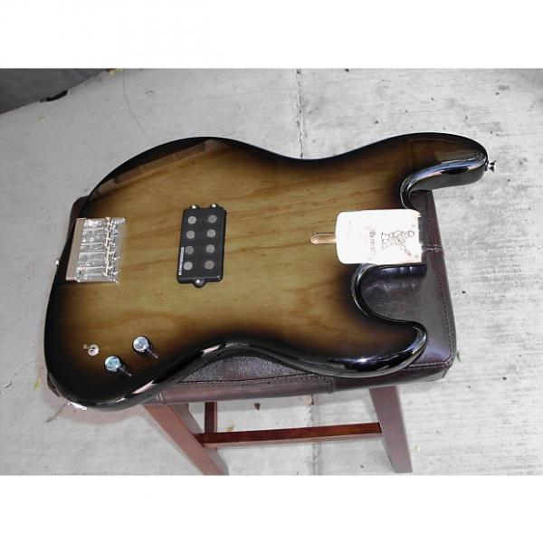 Custom WARMOTH swamp ash with duncan musicman series parallel switch in blackburst transparent #1 image