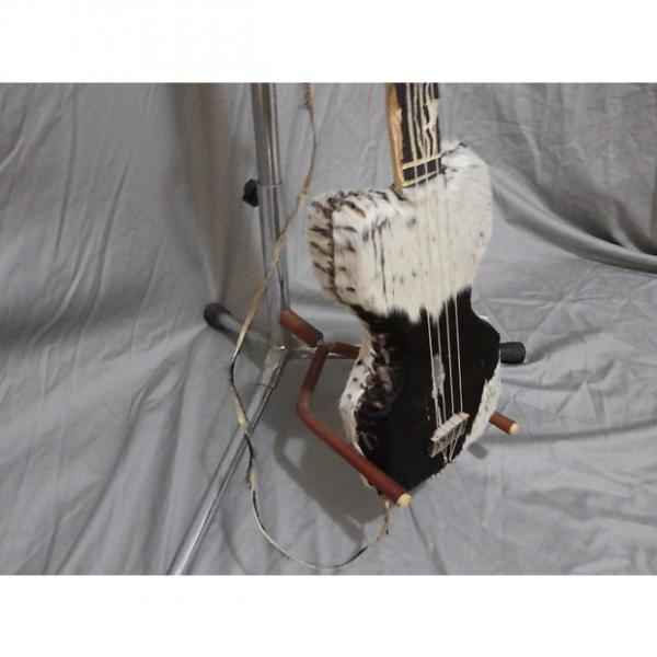 Custom Fur and Raw Hide Cigar Box Guitar (Noisemaker, Wallhanger) #1 image